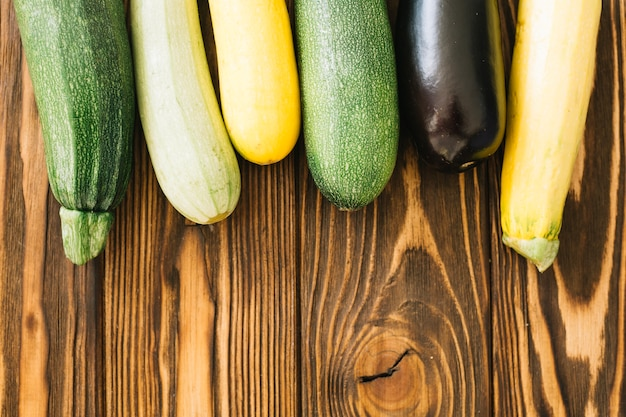 Zucchini on wooden table Free Photo