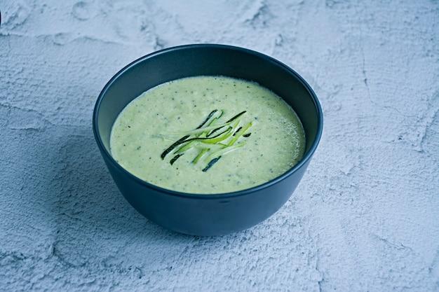 Zucchini puree soup and basil Premium Photo