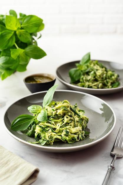 Zucchini vegan pasta on white background. vegetarian healthy food Premium Photo