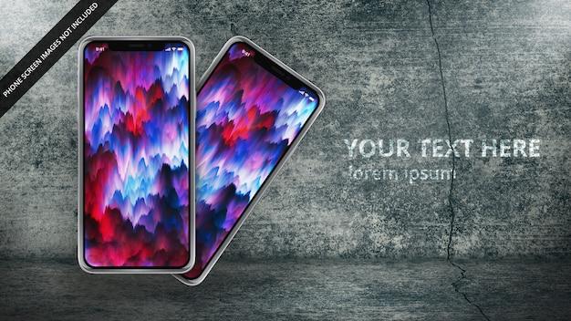汚れたコンクリートの設定で2つのapple iphone x Premium Psd