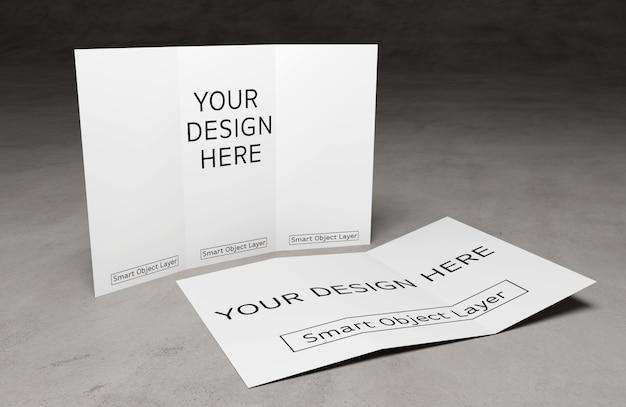 セメントテーブルモックアップの3つ折りパンフレットのビュー Premium Psd