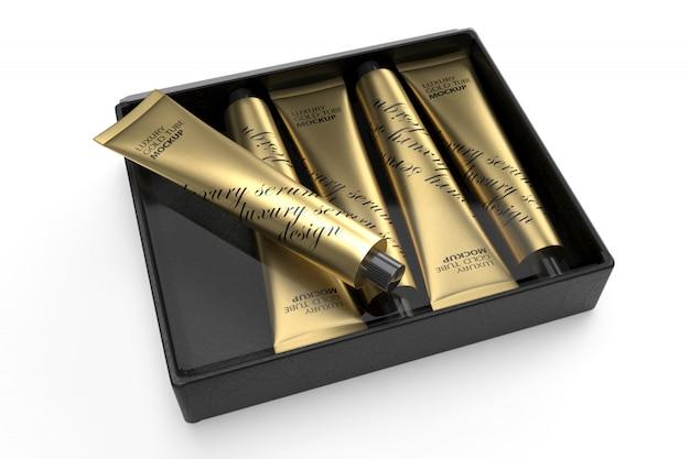 3d дизайн упаковки макет из пяти роскошных золотых трубок в черном ящике Premium Psd