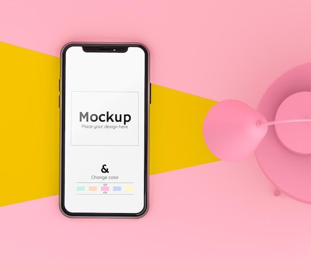 바닥에 휴대폰을 비추는 램프와 편집 가능한 색상이있는 3d 분홍색과 노란색 장면 무료 PSD 파일