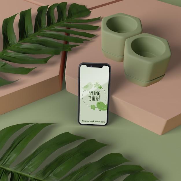 Макет 3d украшения с мобильного на столе Бесплатные Psd