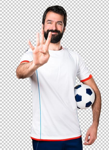 4人のサッカーボールを保持しているサッカー選手 Premium Psd