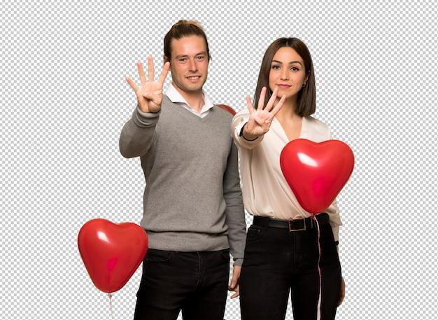 幸せなバレンタインデーのカップルと指で4つを数える Premium Psd