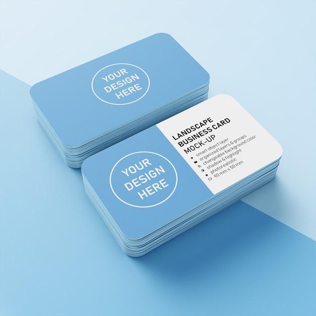 Готовые макеты шаблонов дизайна из двух сложенных 90x50 мм реалистичных пейзажей визитной карточки с закругленным углом в верхнем виде Premium Psd