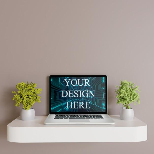 Макет ноутбука на белой стене стол с растениями, вид спереди Premium Psd