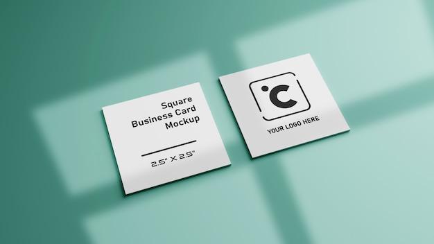 Белый квадратной формы макет визитной карточки на зеленый мятный пастельный цвет Premium Psd