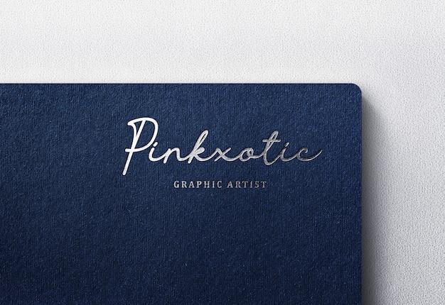 Роскошный логотип макет на темной крафт-бумаге Premium Psd