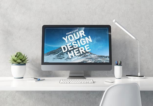 白いデスクトップコンクリートインテリアモックアップ上のコンピューター Premium Psd