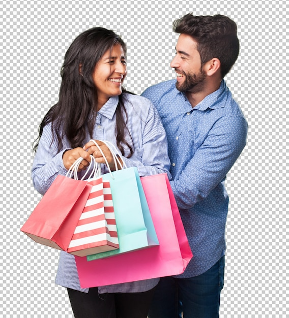 買い物袋を保持している若いカップル Premium Psd