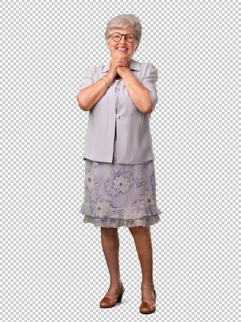 Полное тело старшей женщины очень счастливое и возбужденное, поднимает руки, празднует победу или успех, выигрывает в лотерею Premium Psd