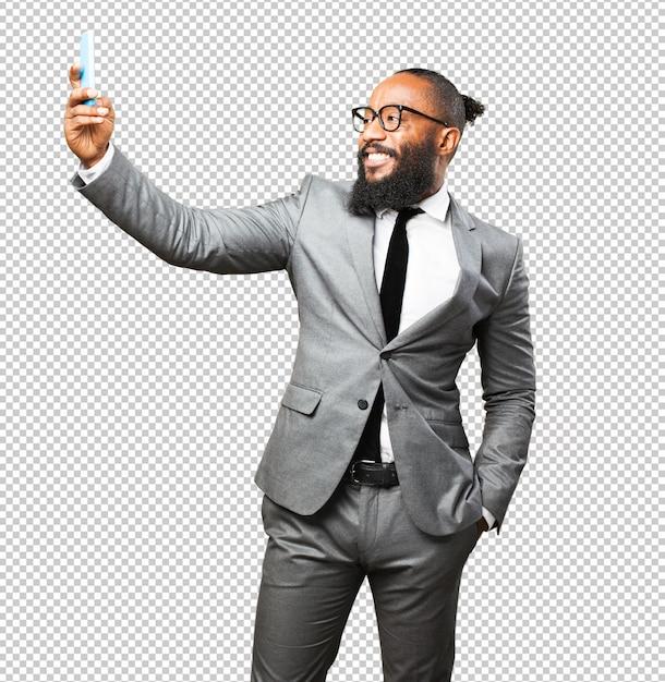 Бизнес черный человек, принимая селфи Premium Psd