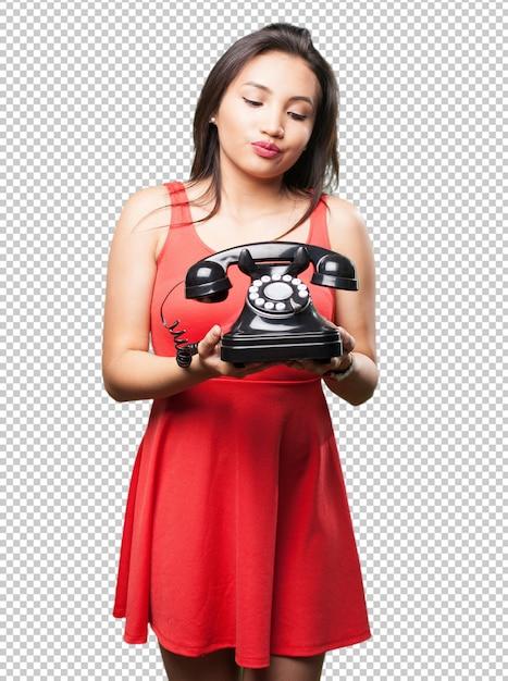 電話を保持しているアジアの女性 Premium Psd