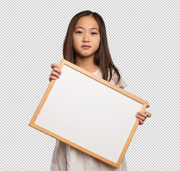 空白のプラカードを保持している中国の少女 Premium Psd