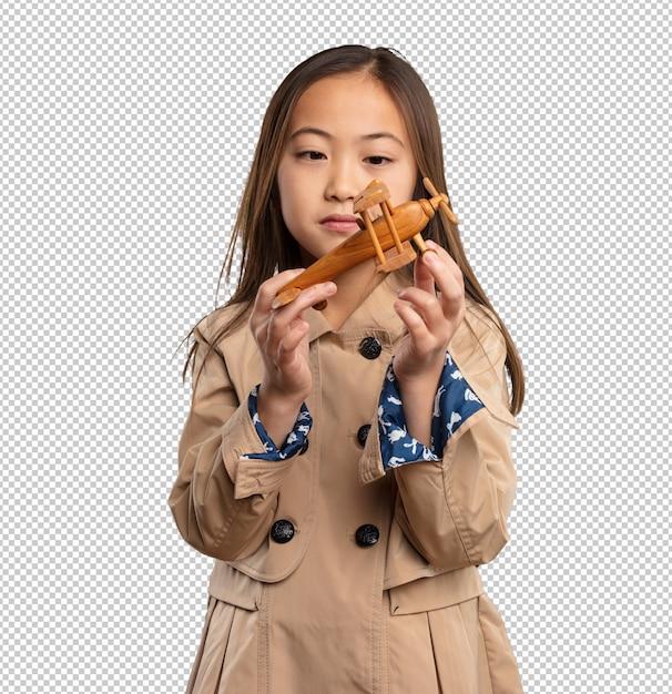 飛行機を保持している中国の少女 Premium Psd