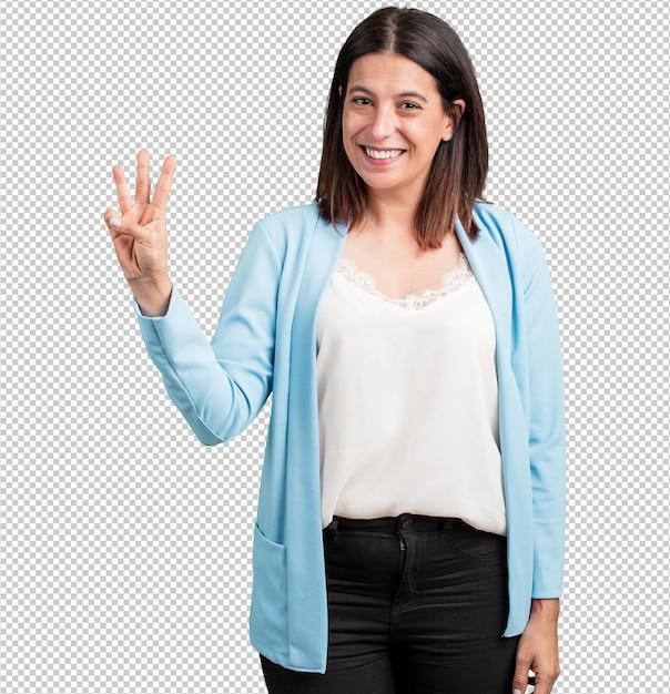 Среднего возраста женщина показывает номер три, символ подсчета, математики, уверенный и веселый Premium Psd