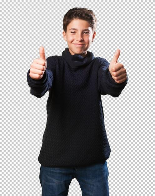 オーケーシンボルをやっている小さな男の子 Premium Psd