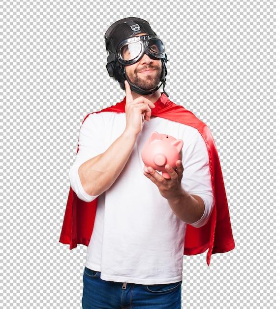 Супер герой держит копилку Premium Psd