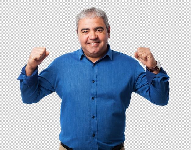 勝利のジェスチャーをしている中年の男性の肖像画 Premium Psd