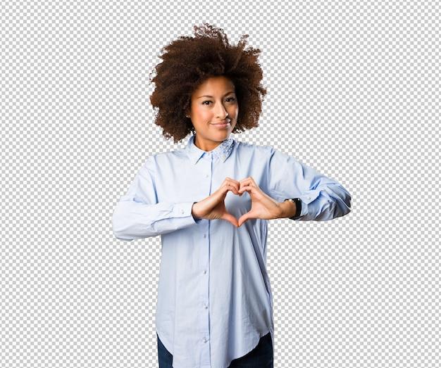 Молодая негритянка делает символ сердца Premium Psd