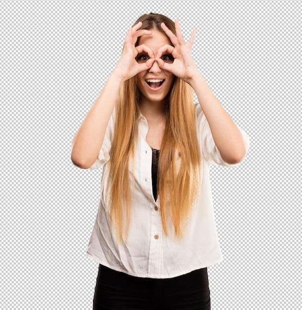メガネのジェスチャーをしているかなり若い女性 Premium Psd