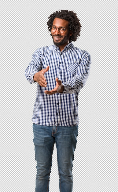 ハンサムなビジネスアフリカ系アメリカ人男性が誰かに挨拶するために手を差し伸べたり、助けに身振りで示す、幸せと興奮 Premium Psd