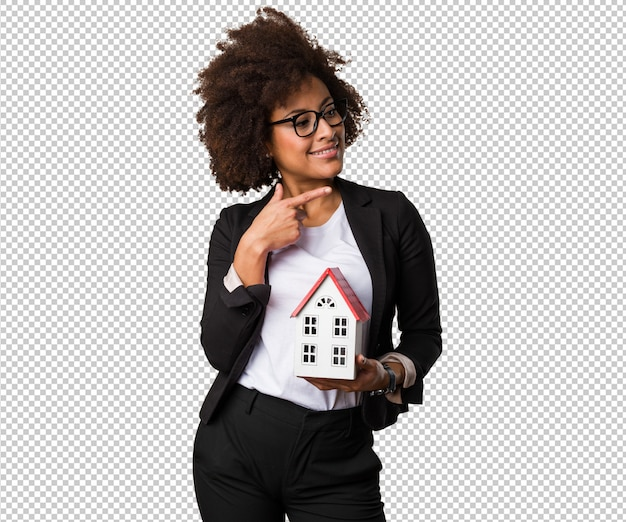 Бизнес черная женщина, держащая небольшой дом Premium Psd