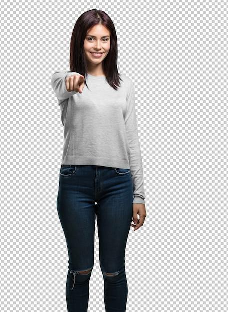 Молодая красивая женщина, веселый и улыбающийся, указывая на фронт Premium Psd