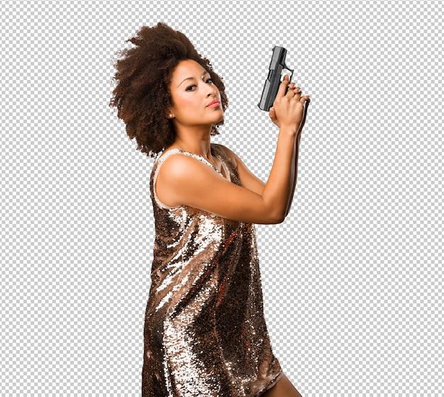 銃を使用して若い黒人女性 Premium Psd