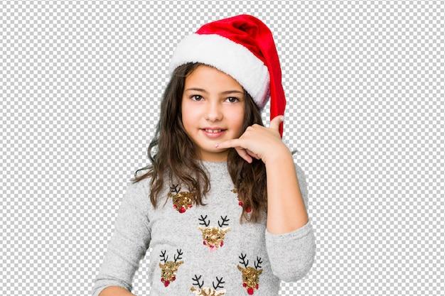 指で携帯電話呼び出しジェスチャーを示すクリスマスの日を祝っている少女。 Premium Psd