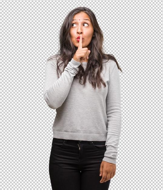 Портрет молодой индийской женщины, держащей в секрете или просящей молчание, серьезное лицо Premium Psd