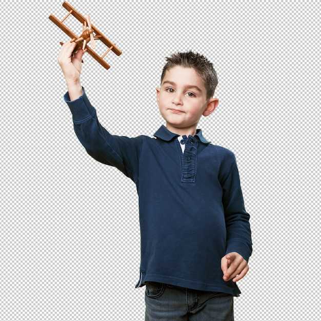 Маленький ребенок, играющий с бипланом Premium Psd