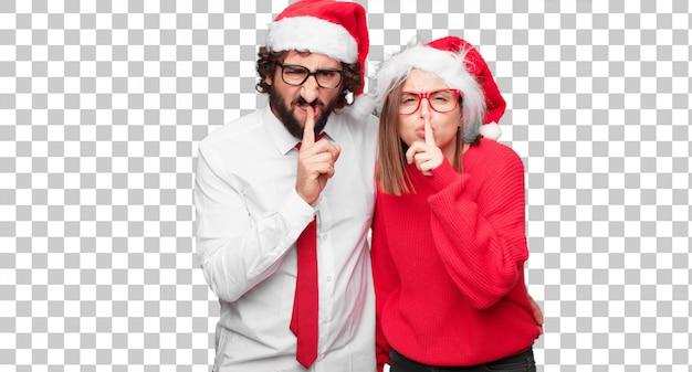 クリスマスの概念を表現する若いカップル。カップルと異なるレイヤーの背景 Premium Psd