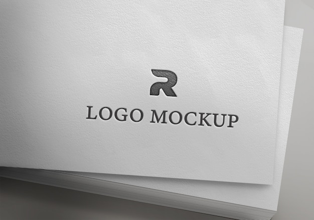 Серебряный логотип макет на бумаге Premium Psd