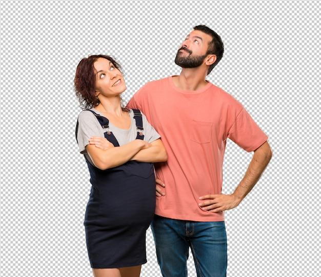 笑いながら妊娠中の女性と恋人 Premium Psd