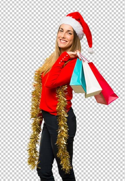 ブロンドの女性はクリスマス休暇のために服を着た Premium Psd