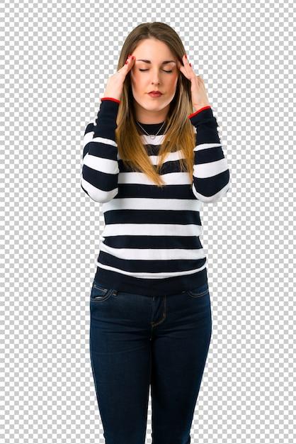 金髪の若い女の子は不幸で何かに不満を感じています。否定的な表情 Premium Psd