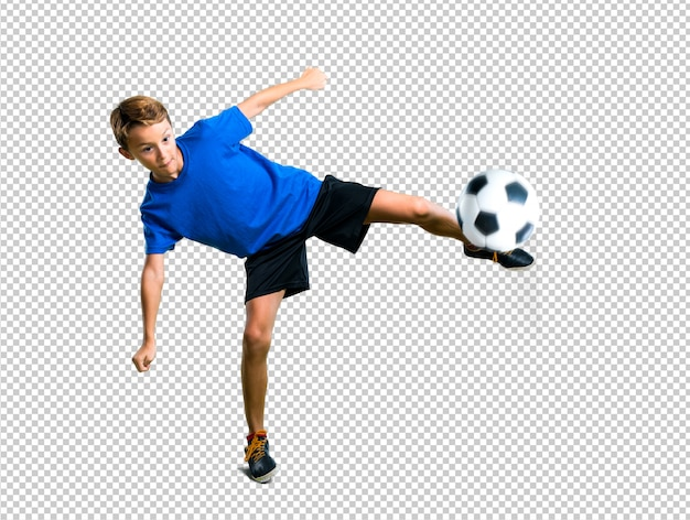 サッカーボールを蹴る少年 Premium Psd