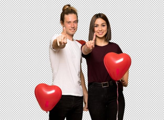バレンタインの日を示すと指を持ち上げるのカップル Premium Psd