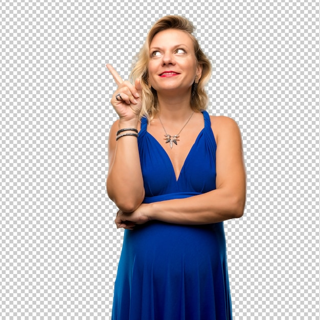 人差し指で素晴らしいアイデアを指している青いドレスと妊娠中のブロンドの女性 Premium Psd