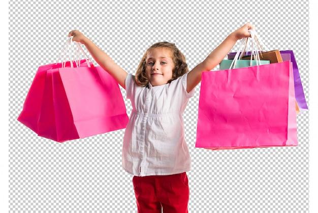 多くの買い物袋を持つ少女 Premium Psd