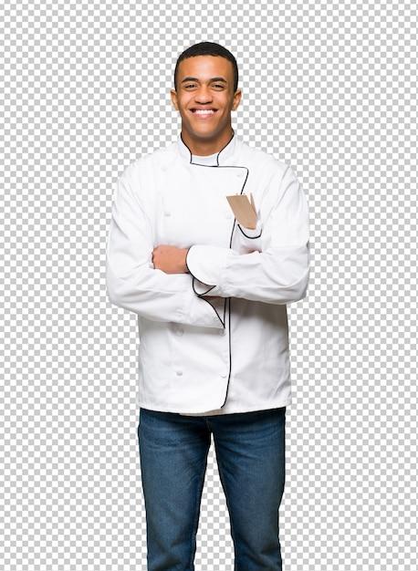 Молодой афро-американский шеф-повар, счастливый и улыбающийся Premium Psd