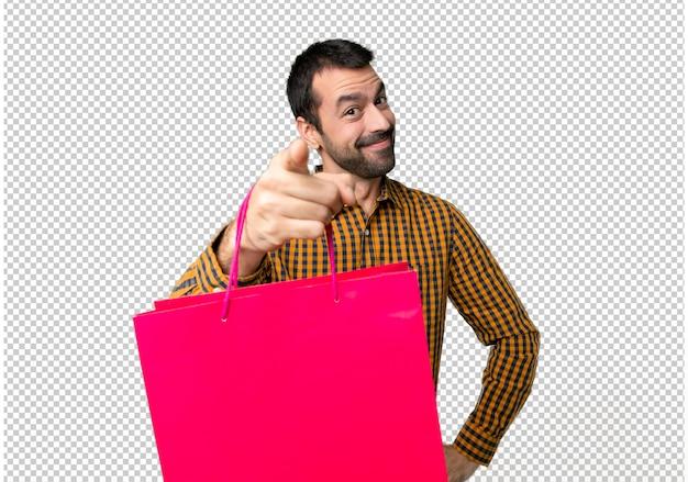 買い物袋を持つ男は自信を持って表情であなたに指を指す Premium Psd