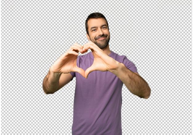 Красивый мужчина делает символ сердца руками Premium Psd