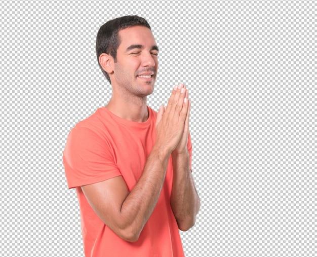 希望の若い男が祈っている Premium Psd
