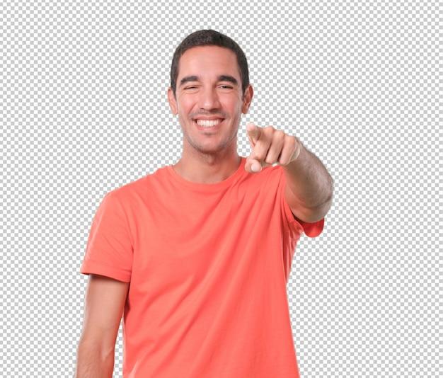 Смешные молодой человек, указывая вам рукой Premium Psd
