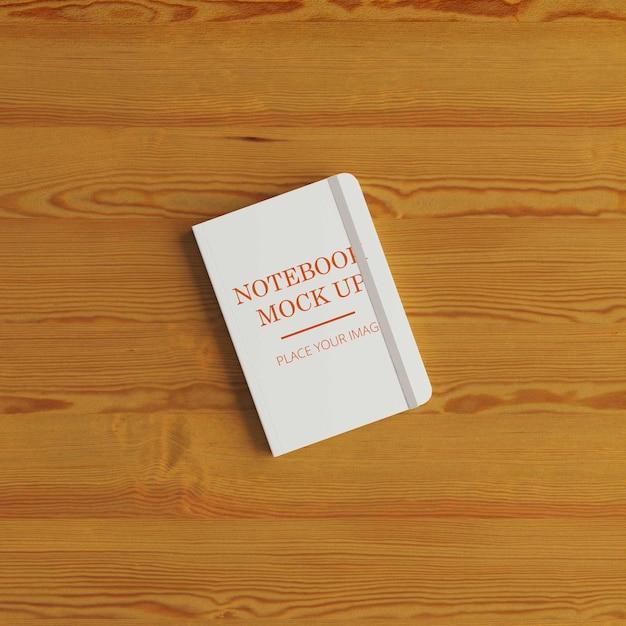 床にモックアップされたノートブック Premium Psd