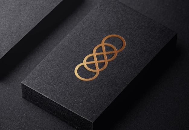 Роскошный золотой логотип макет на тисненой визитной карточке Premium Psd
